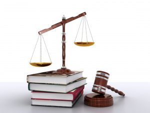 Law books balance and gavel - California student loan service statute